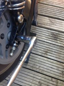 Loosen axle nut