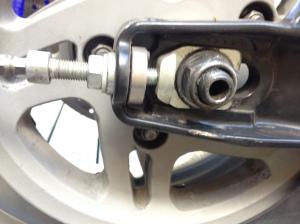 Rear wheel adjuster